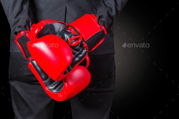 Businessman with boxing glove - Stock Photo - Images
