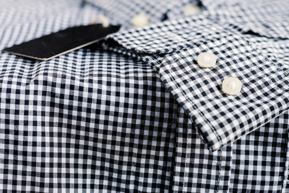 Button on sleeve of shirt - Stock Photo - Images