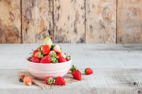 Strawberry on wooden floor - Stock Photo - Images
