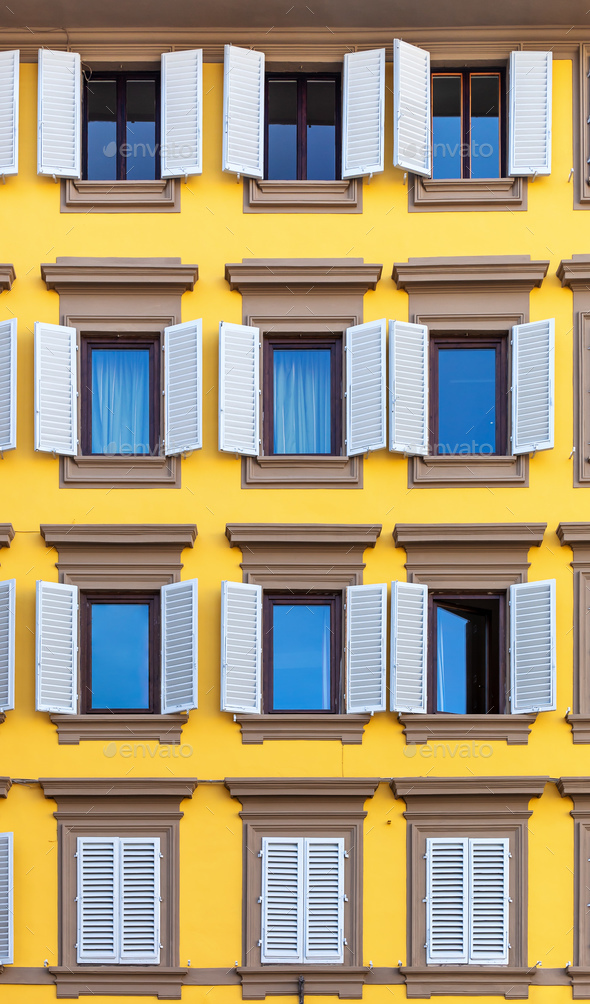 Windows on yellow facade - Stock Photo - Images
