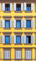 Windows on yellow facade