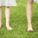 Children Feet on Green Grass - VideoHive Item for Sale