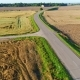 Flight Over Road in Summer Field - VideoHive Item for Sale
