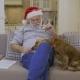 Cute Dog Asks Some Snack in Senior Man Wearing Santa's Hat
