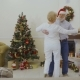 Senior Couple Dancing Near Christmas Tree - VideoHive Item for Sale