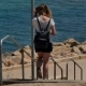 Young Girl Walking Down the Stairs To the Sea - VideoHive Item for Sale