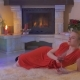 Beautiful Woman in Red Dress Drink Wine and Lies on Carpet Near Christmas Tree - VideoHive Item for Sale