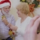 Happy Old Couple Decorate Christmas Tree Together - VideoHive Item for Sale