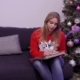 Young Girl Write Letter Sitting at Sofa Near Christmas Tree - VideoHive Item for Sale