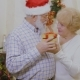 Mature Woman with Mature Man Hold Christmas Gift in Hands - VideoHive Item for Sale