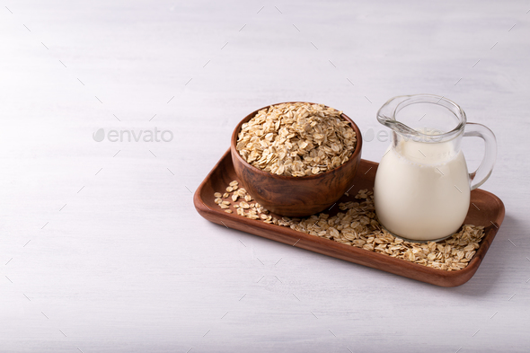 Oat flakes and milk - Stock Photo - Images