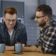 Two Male Friends Sit By Kitchen Table and Chat. Caucasian Men Share a Friendly Conversation with - VideoHive Item for Sale