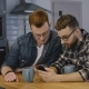 Business Colleagues Discuss New Ideas. Mobile Office. Two Caucasian Men Talk Using Smartphone - VideoHive Item for Sale