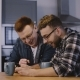Two Male Friends Watch Funny Videos Online. Handsome Happy European Men Using Smartphone with Coffee - VideoHive Item for Sale