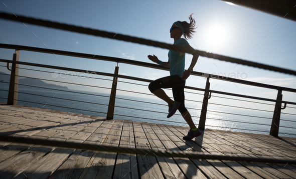 Running on sunrise coast boardwalk - Stock Photo - Images