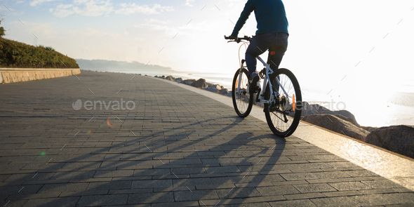 Riding bike on seaside  - Stock Photo - Images