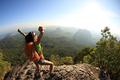 Successful hiker on sunrise mountain
