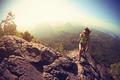 Hiking on mountain top cliff edge