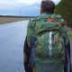 A Young Tourist Travels with a Backpack on His Shoulders - VideoHive Item for Sale