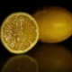 Two Juicy Lemons Lie on a Dark Background - VideoHive Item for Sale