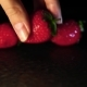 Hand Puts Strawberries on a Wet Surface in the Dark - VideoHive Item for Sale