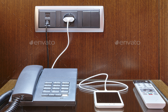 Loading smart phone. Hotel room desk. Travel business background. Equipment - Stock Photo - Images