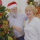 Happy Mature Couple Decorate Christmas Tree - VideoHive Item for Sale