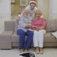 Grandson in Santa's Hat Hugs Grandparents - VideoHive Item for Sale