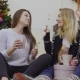 Young Pretty Girls Eats Marshmallows Sitting on Floor Near Christmas Tree - VideoHive Item for Sale