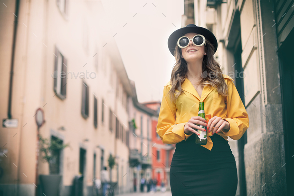 Girl waking in town - Stock Photo - Images