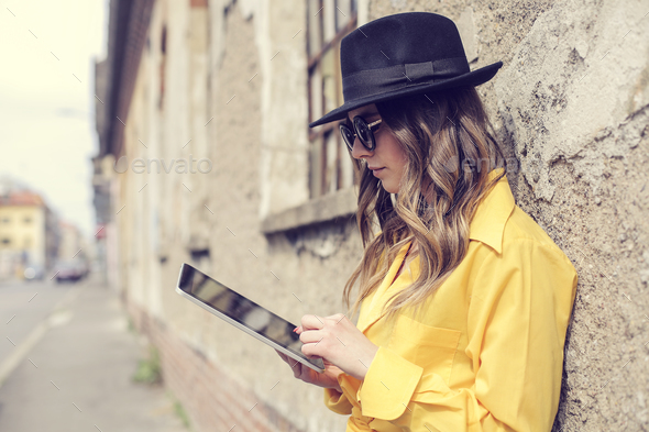 Girl with a tablet outdoor - Stock Photo - Images