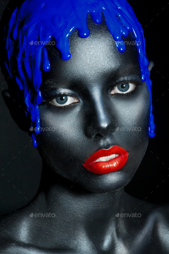 fashion portrait of a dark-skinned girl with color make-up. Beauty face. - Stock Photo - Images
