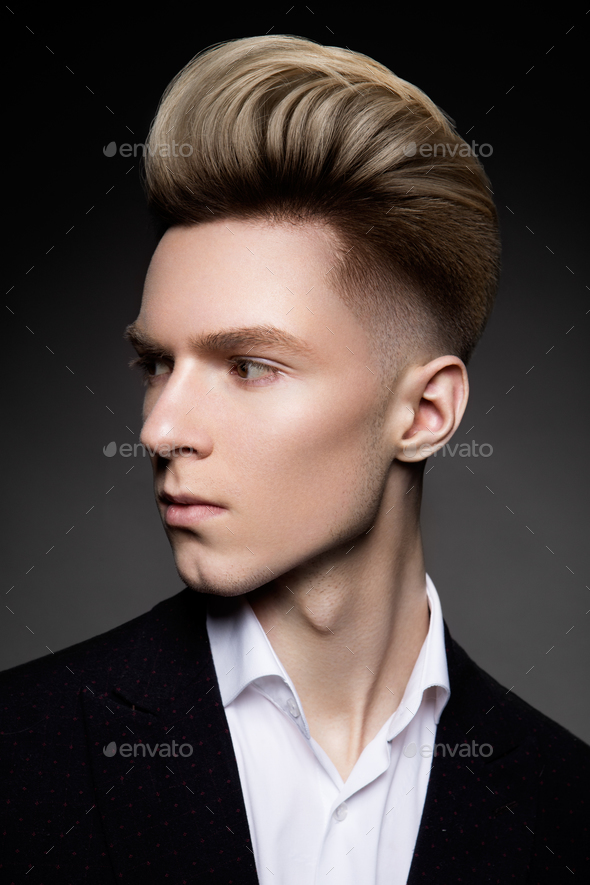 Side view portrait of thinking stylish young man - Stock Photo - Images