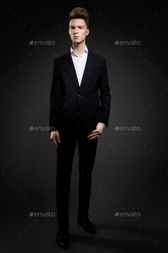 Portrait of handsome man in black suit - Stock Photo - Images