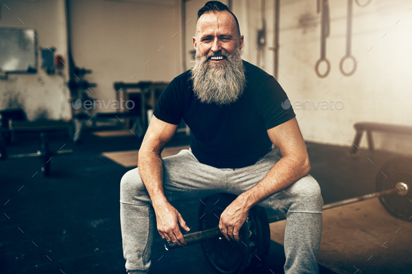 Mature man laughing while taking a break from working out - Stock Photo - Images