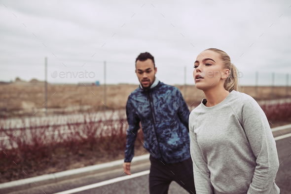 Young couple catching their breath while out for a jog - Stock Photo - Images