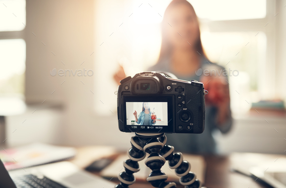 Blogger with refreshing drink making video podcast - Stock Photo - Images
