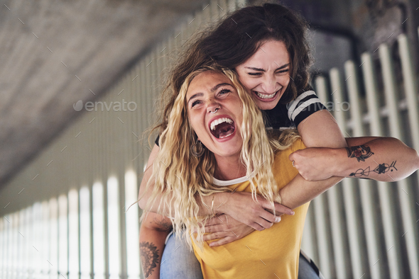 Best friends laughing and having a fun night out together - Stock Photo - Images