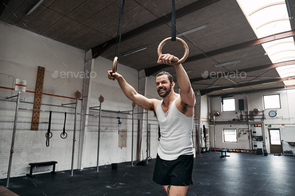 Fit young man taking a break from working out - Stock Photo - Images