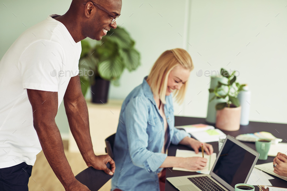 Two smiling business colleagues working together in an office - Stock Photo - Images