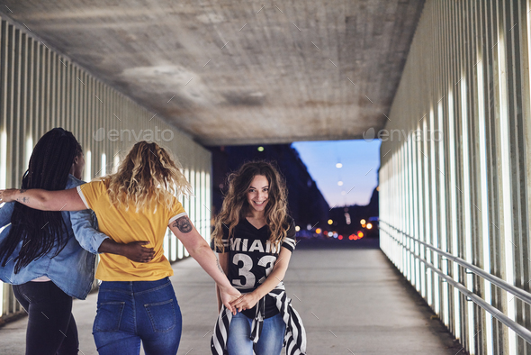 Girlfriends having a fun night out together in the city - Stock Photo - Images