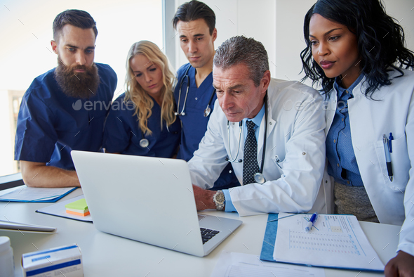The medicine workers standing and browsing laptop - Stock Photo - Images