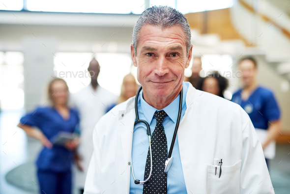 Portrait of adult cheerful doctor in hospital - Stock Photo - Images