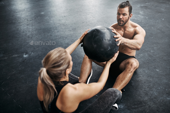 Fit people exercising with a medicine ball at the gym - Stock Photo - Images