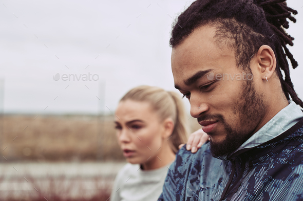 Young man and his girlfriend out for a run together - Stock Photo - Images