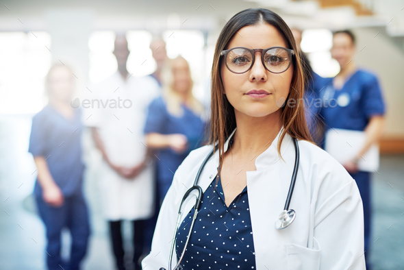 Pensive female medical worker in a hospital - Stock Photo - Images