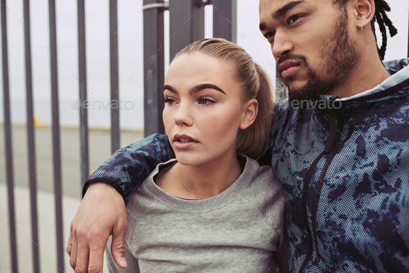 Focused young couple in sportswear ready for an outdoor run - Stock Photo - Images