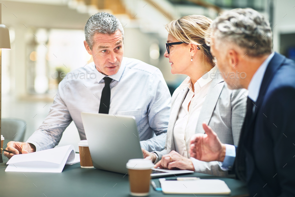 Mature corporate colleagues meeting together in a modern office - Stock Photo - Images