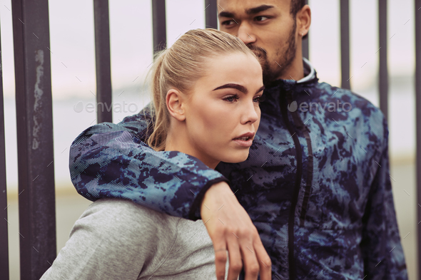 Young couple in sportswear ready for an outdoor run - Stock Photo - Images