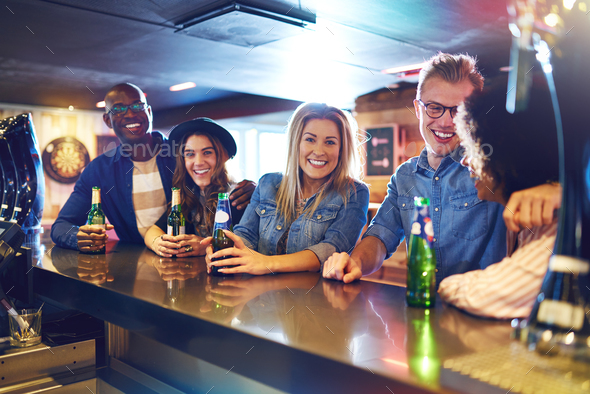 Happy group of people drinking in bar - Stock Photo - Images